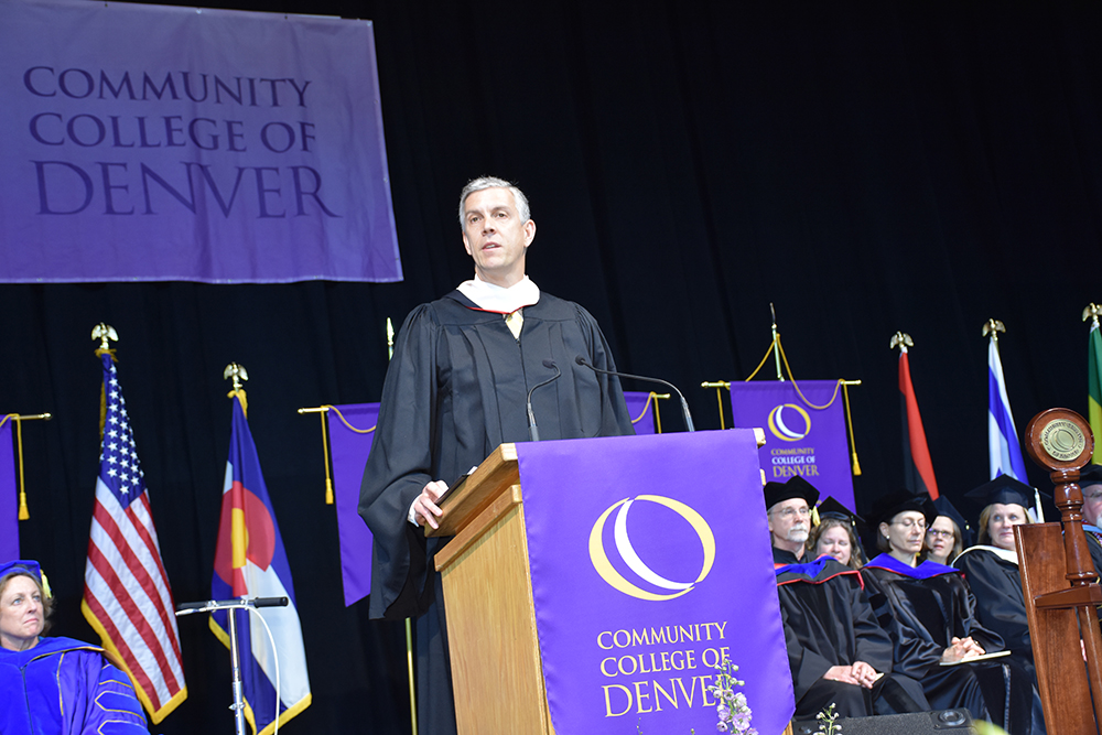 CCD commencement speaker at podium