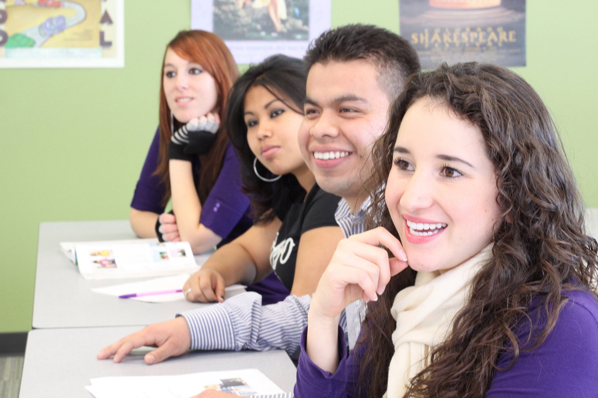 Four CCD students smiling at professor