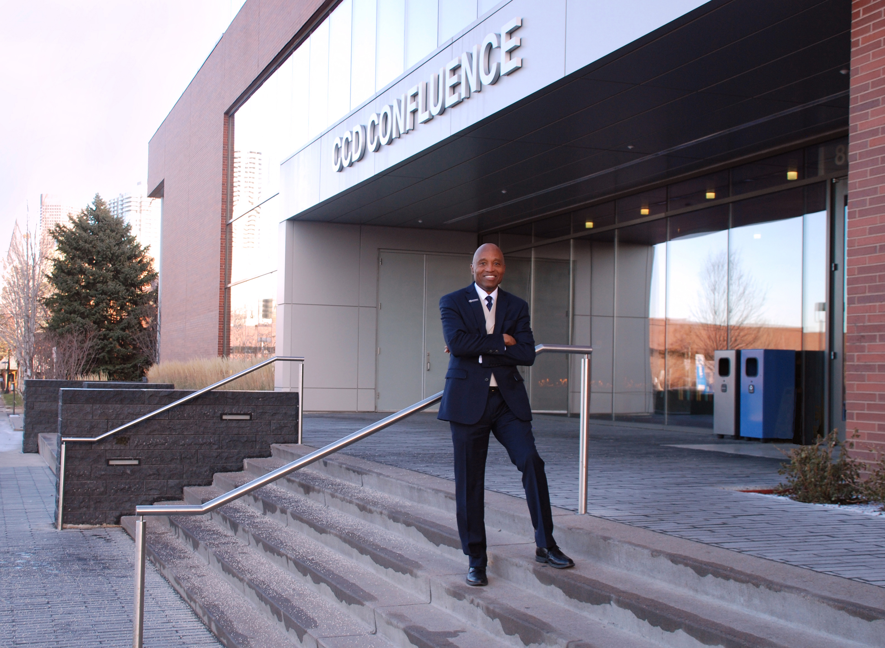 a man standing on the steps in front of a building