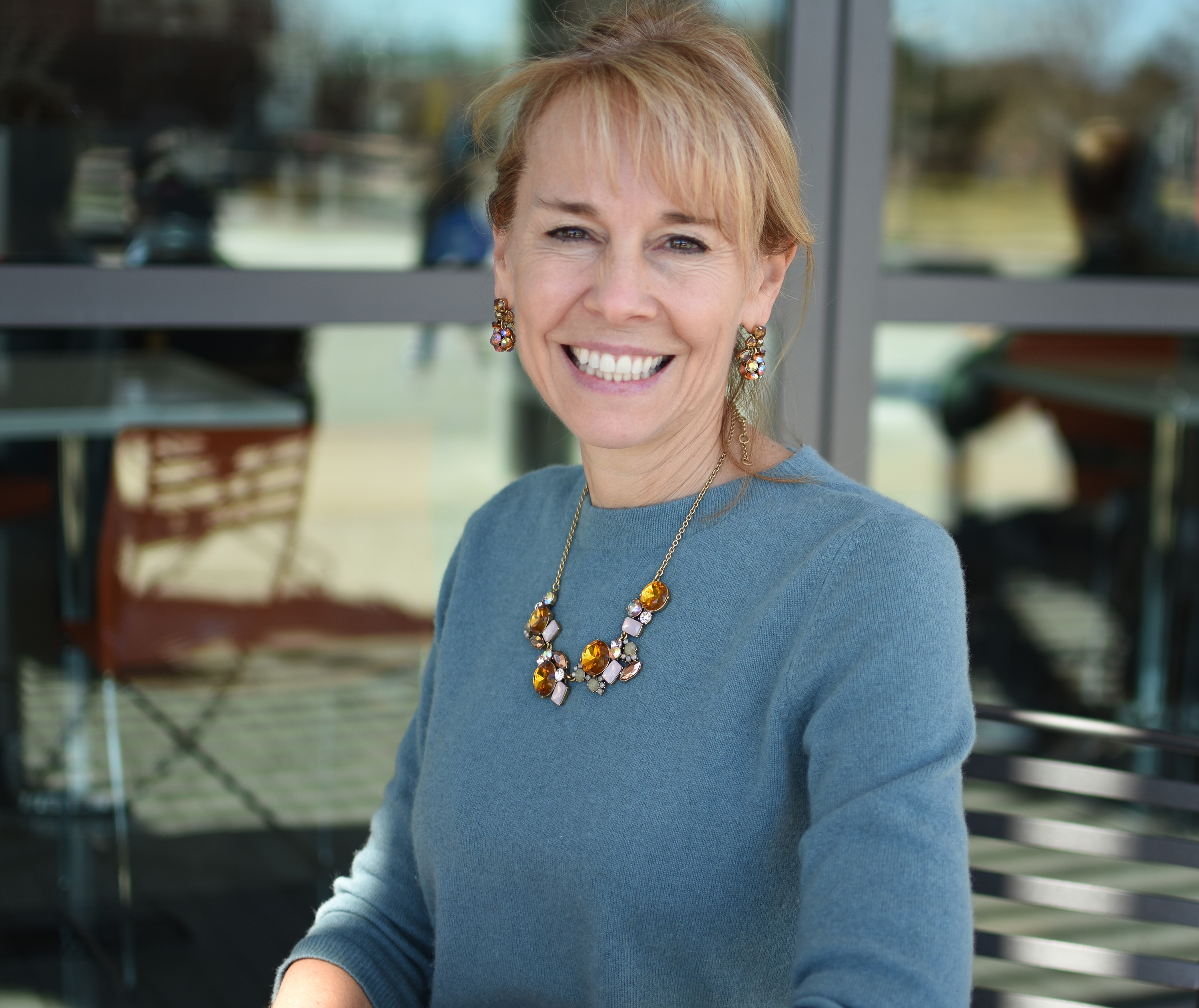 woman smiling sitting on a patio