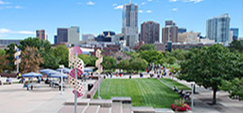 Image of the Auraria Campus with the Denver skyline in the background.