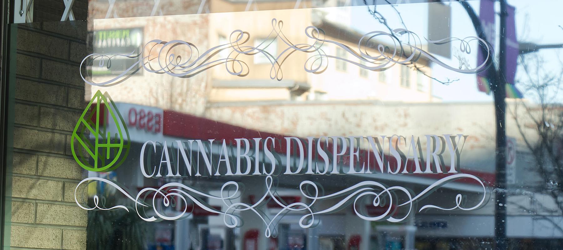Cannabis dispensary sign on retail window