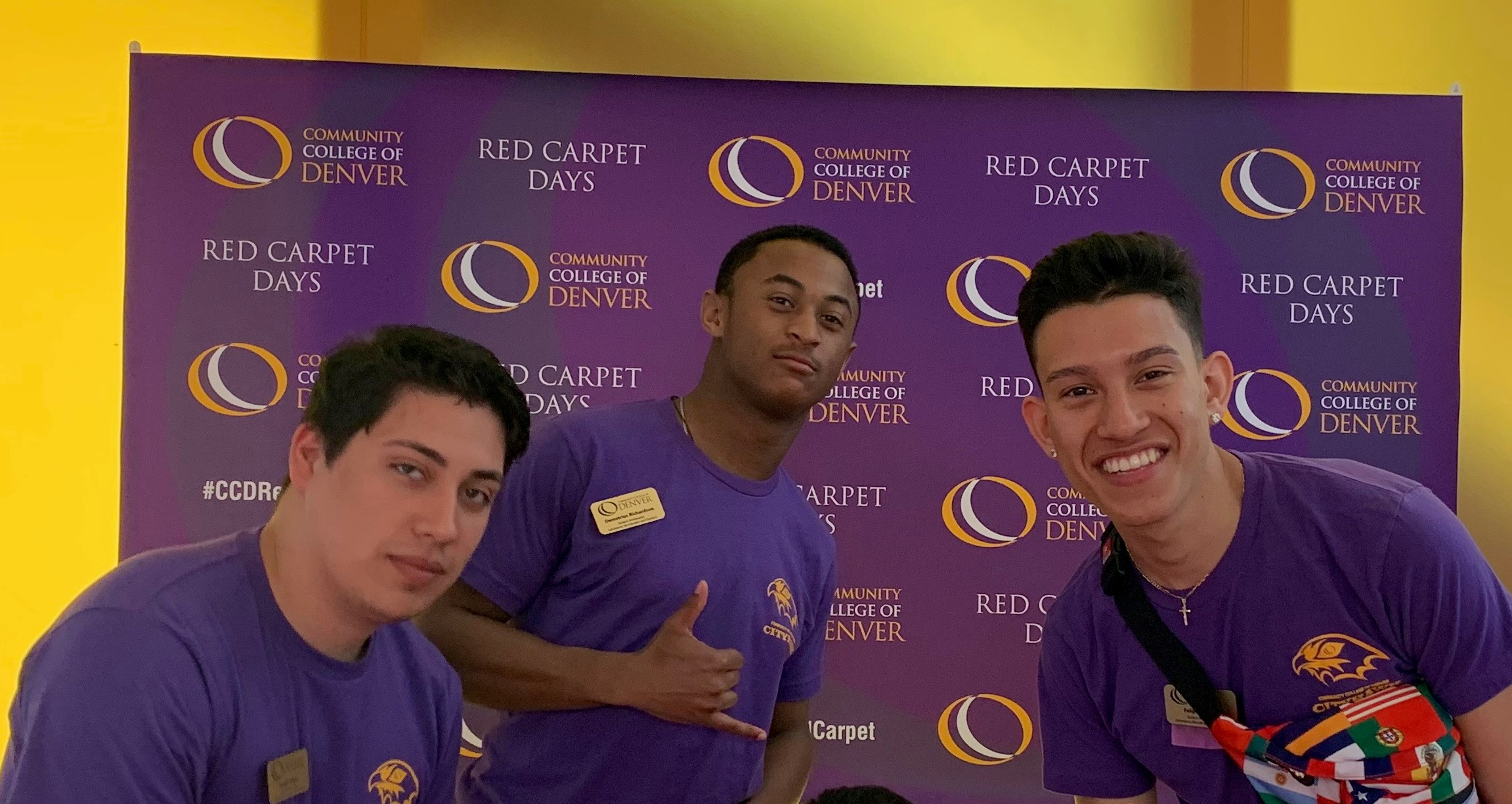 three males with purple CCD shirts posing