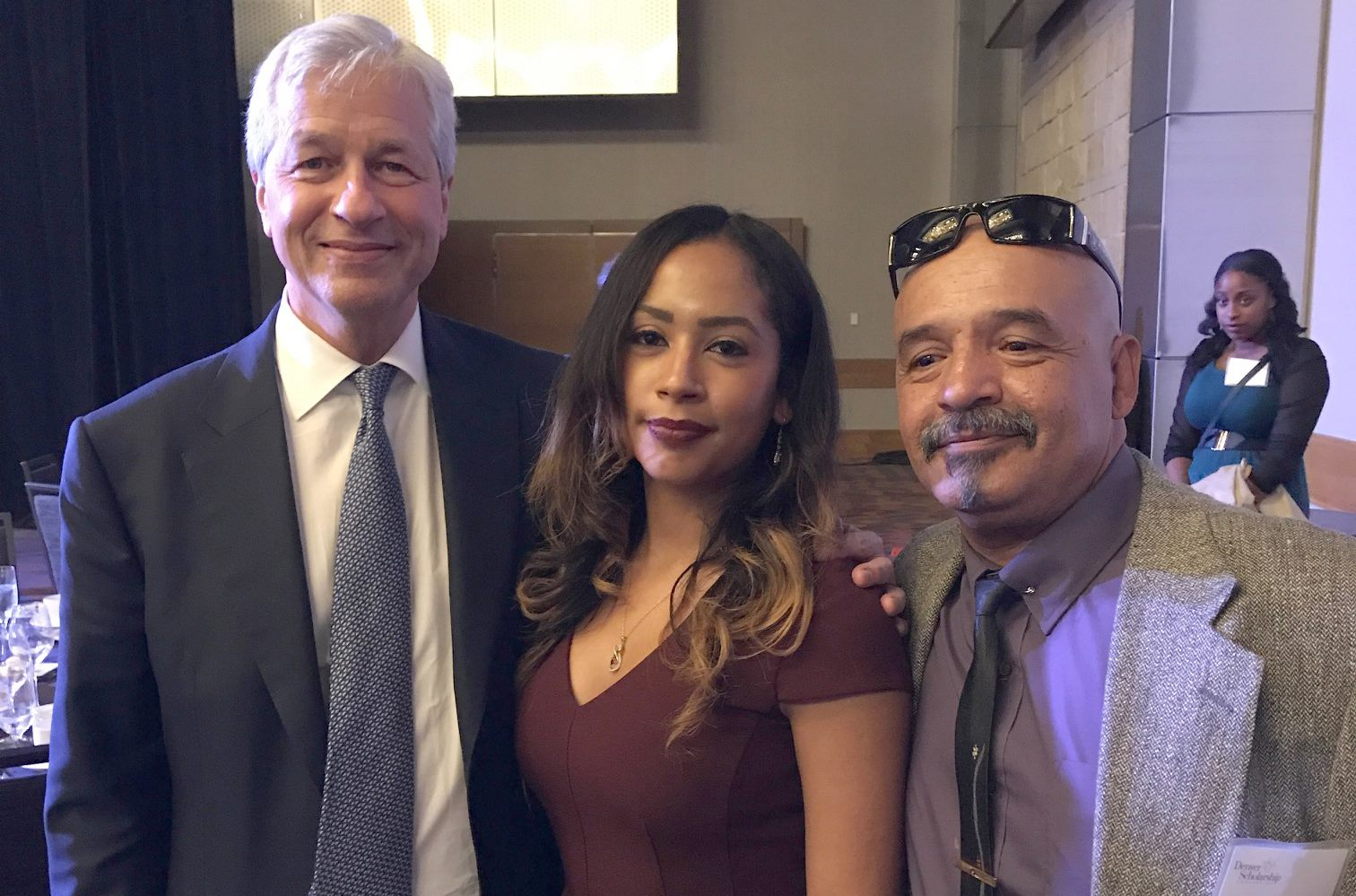 a white man and Hispanic woman and man standing together smiling