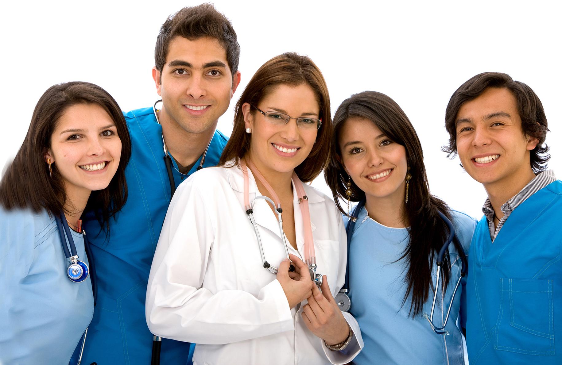 Smiling group of nurses wearing blue scrubs