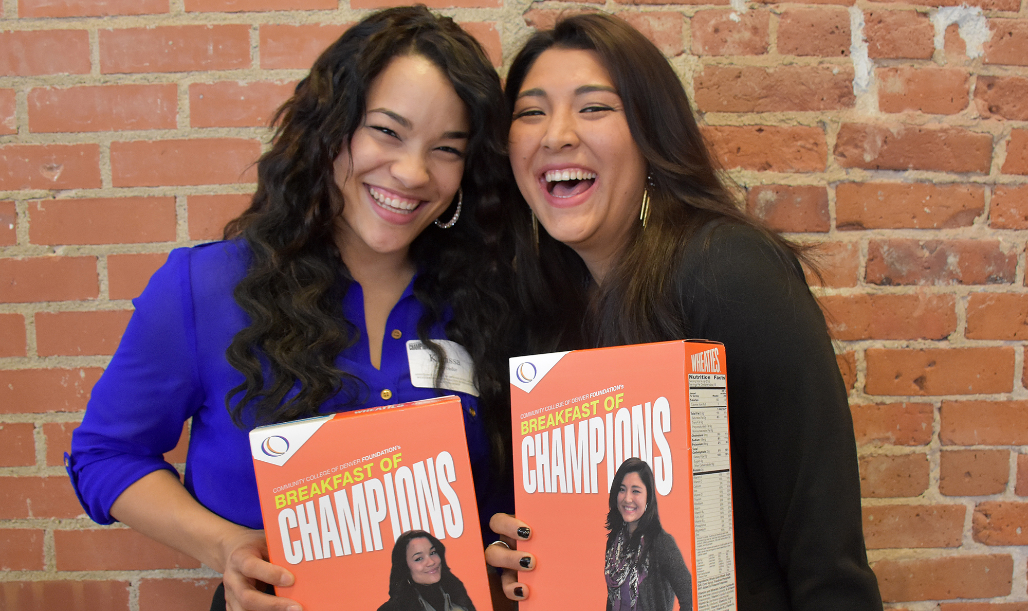 two females holding cereal box of Breakfast of Champions