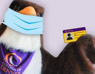 college mascot with protective mask on holding student ID