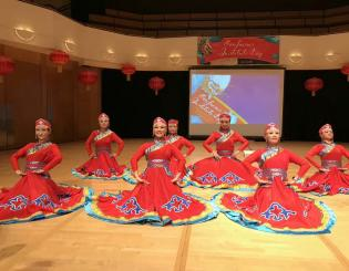 female chinese dancers in matching red dresses