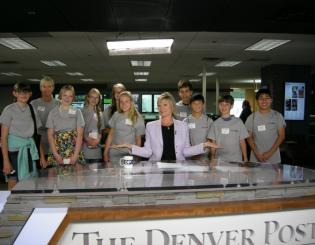 students at The Denver Post with TV news anchor