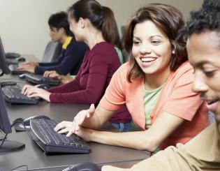 Male and female students working at computers