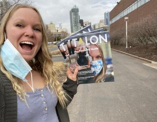 ccd student Jenna Duke hold a copy of the talon