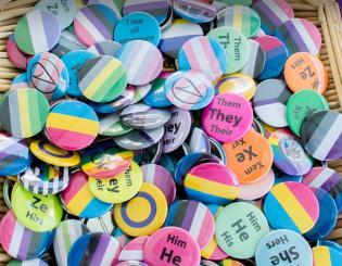 basket of LBGTQ affirming buttons