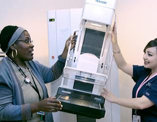 two women working with a mammography machine
