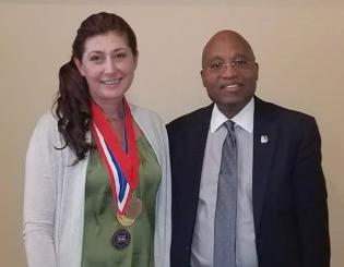 white woman and black man standing next to each other smiling
