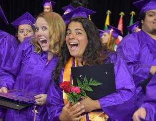 female grads smile at commencement