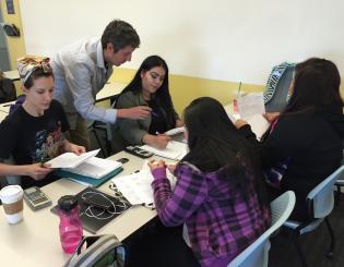 a teacher helping 4 female students