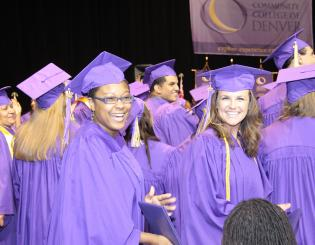 Group of CCD Graduates wearing purple graduation gowns at the 2014 Commencement Ceremony