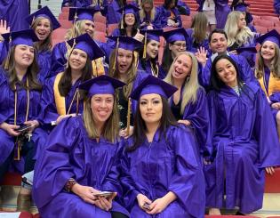 CCD graduates in purple gowns