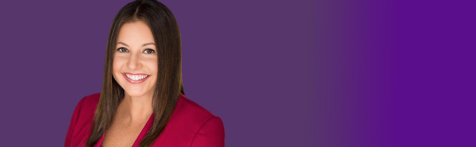 woman wearing a red blazer with purple background