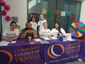 Volunteers at the CCD Somos Sign in and Prize tables