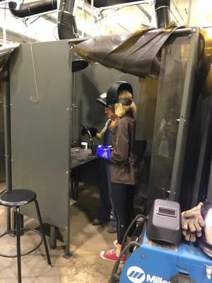 two females welding