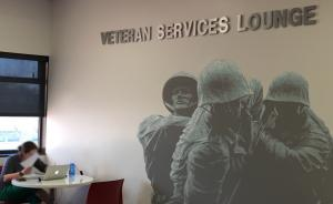 veteran memorial image with sign that says Veteran Services Lounge