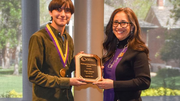 young man being presented the Distinguished Student Award