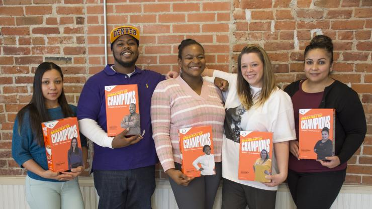 a group of students holding Breakfast of Champion cereal boxes