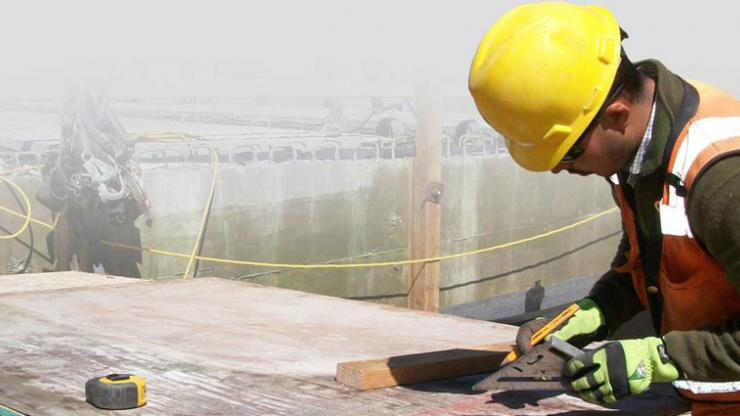 Hispanic Male Contractor at Work on Construction Site