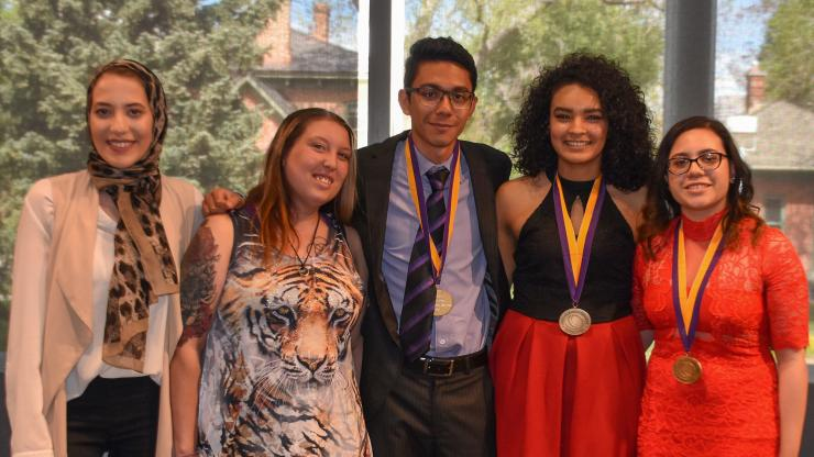 five students wearing medals around their necks