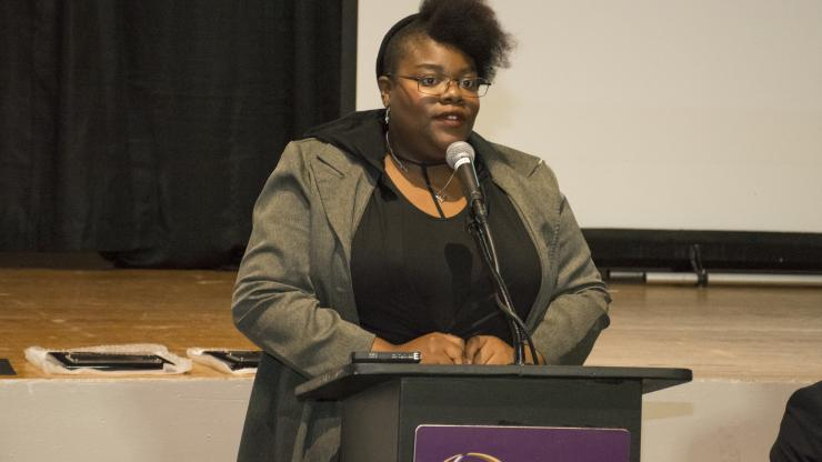 CCD student speaks at podium during MLK celebration event