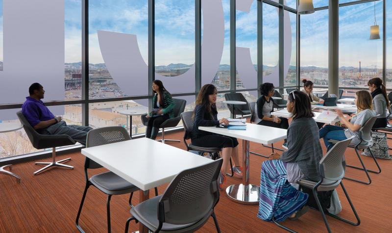 Group of students sitting in a study lounge in the Confluence building.