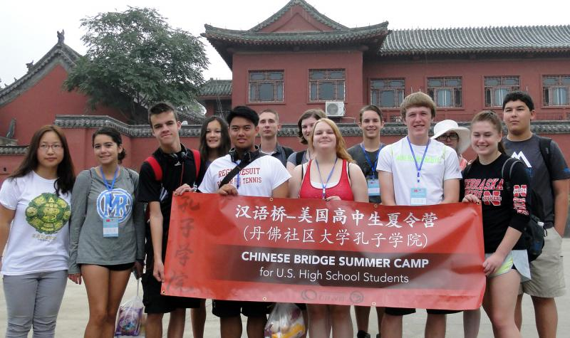 group of students in China holding a red banner