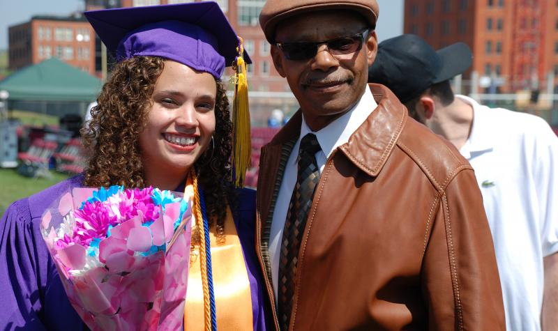 Female CCD graduate standing next to a man after Commencement Ceremony.