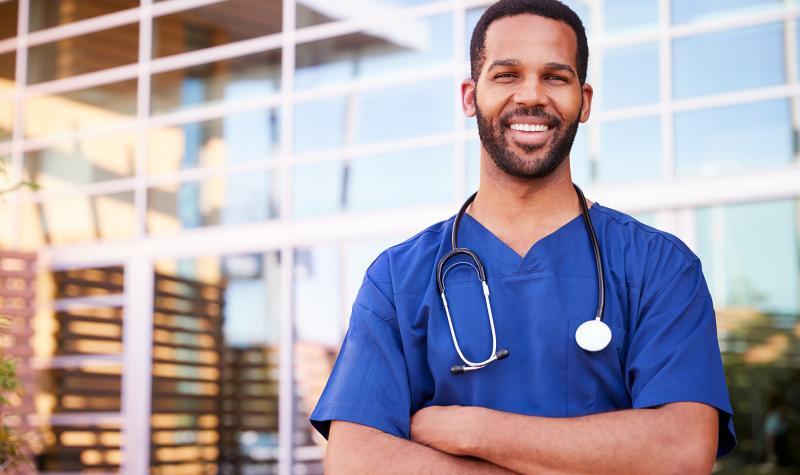 Person wearing medical scrubs.