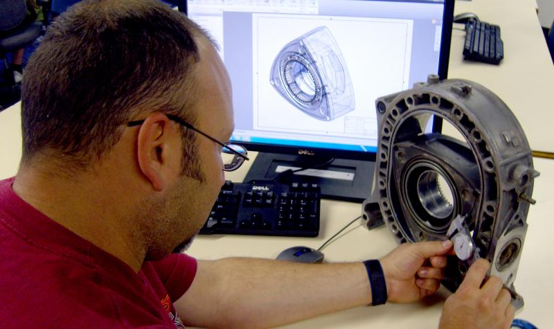 person measuring rotary motor