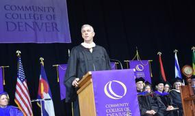 CCD commencement speaker at podium