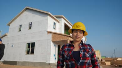 woman in hard hat outside at a construction site