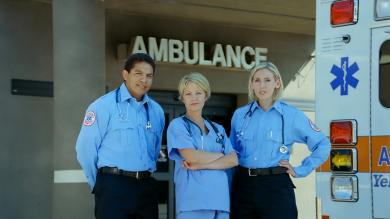 Emergency Medical team by an ambulance at a hospital