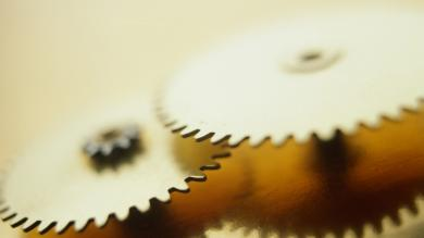 a close up photo of clock gears