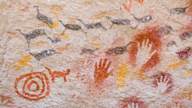 Ancient cave paintings of hands and animals