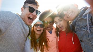 students smiling with sunglasses