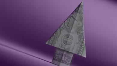 dollar bill folded into an arrow
