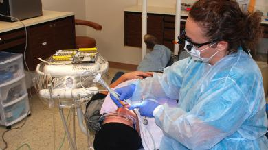 dental hygienist working on a patient