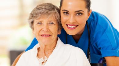 image of a woman nurse with an older woman patient