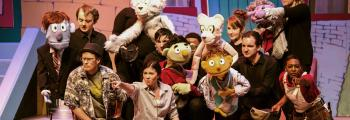 group on stage in a production with puppets